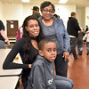 (Brad Davis/The Register-Herald) 8-year-old 2nd grader Jordan Minor poses for a quick photo with his mom Rakeisha and grandmother Drema during a special Soul Food Luncheon Friday morning at Stratton Elementary School.