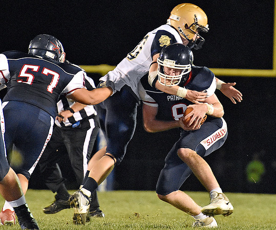 (Brad Davis/The Register-Herald) Independence quarterback Adam Daniels is caught and hit in the backfield by Shady Spring's Issac Harvey Friday night in Coal City.