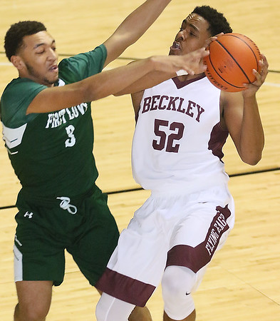 (Brad Davis/The Register-Herald) Woodrow Wilson's Breland Walton drives to the basket as First Love Christian's Christian Bentley defends during the championship game of the Battle for the Armory Basketball Tournament Friday night at the Beckley-Raleigh County Convention Center.