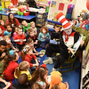 Larry Ford, dressed as The Cat in the Hat, reads to kidergarten students at Stanaford Elementary School Wednesday morning.<br /> (Rick Barbero/The Register-Herald)