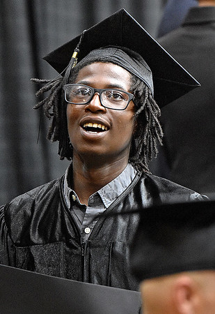 (Brad Davis/The Register-Herald) Graduate Shamar Wood looks up to friends and family congratulating him from the balcony after collecting his welding certificate during the Academy of Careers and Technology's 2017 Awards ceremony Thursday night at the Beckley-Raleigh County Convention Center.