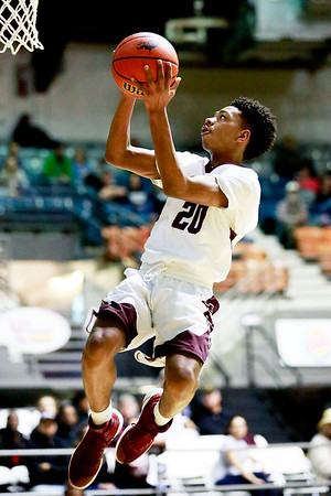 Woodrow Wilson's Mikey Penn goes up for a layup on a fast-break during the second quarter of their basketball game against George Washington at the Beckley-Raleigh County Convention Center in Beckley on Tuesday. (Chris Jackson/The Register-Herald)