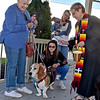 (Brad Davis/The Register-Herald) Paulette Buzbee, left, looks on as her dog Lucy is blessed by Rev. Julie Hay Halstead, lead pastor for Raleigh Shared Ministries during the annual Blessing of the Animals Sunday afternoon under the Word Park gazebo. Morgan Williams, middle, pets Lucy while Peggy Brown looks on with her dog Murphee in the background after being blessed.