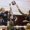 (Brad Davis/The Register-Herald) Shady Spring's Peyton Wiseman, left, and Greenbrier East's Taylor Dunbar, right, try to keep the ball on the other side of the net during the Shirley Brown Invitational Volleyball Tournament Saturday afternoon at Woodrow Wilson High School.