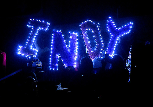 "(Brad Davis/The Register-Herald) Independence fans and family members make sure their presence is known with four giant, lit up letters reading ""Indy"" as the lights were out during pre event festivities at the 70th Annual WVSSAC State Wrestling Tournament Saturday night at the Big Sandy Arena in Huntington."