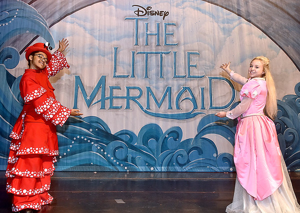 (Brad Davis/The Register-Herald) Sebastian (left), played by Isaac Oglesby, and Ariel, played by Kayla Mills (during select performances) introduce you to Woodrow Wilson High School's rendition of Disney's The Little Mermaid during a rehearsal and photo shoot Friday afternoon inside the school's auditorium.
