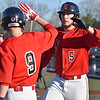 (Brad Davis/The Register-Herald) Liberty's Trenton Begley, right, is congratulated by teammate  Logan Williams after scoring a run during the Raiders' game against Nicholas County Wednesday evening at Linda K. Epling Stadium.