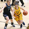 (Brad Davis/The Register-Herald) WVU Tech's Isabel Barrio drives as Mount Vernon Nazarene's Natalie Carpenter defends Tuesday night at the Beckley-Raleigh County Convention Center.