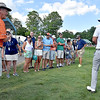 (Brad Davis/The Register-Herald) Greenbrier Classic winner Xander Schauffele, right, has a brief laugh with fans as he makes sure everyone is ok after his fairway shot on #17 went left and into the gallery during final round Greenbrier Classic action Sunday afternoon in White Sulphur Springs.
