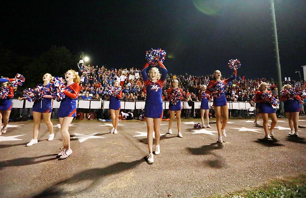 Midland Trail cheerleaders cheer on their side during their football game against Fayetteville Friday in Hico. (Chris Jackson/The Register-Herald)
