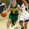 (Brad Davis/The Register-Herald) Greenbrier East's Nathaniel Patton drives as Woodrow Wilson's Josiah Walton defends Friday night at the Beckley-Raleigh County Convention Center.