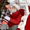 "(Brad Davis/The Register-Herald) Zela Elementary student Serenity Taylor, 5, conveys her Christmas wishes to Santa and Mrs. Claus during the 4th annual "" Santa at the Lighthouse"" event Saturday evening on the grounds of the Summersville Lake Retreat. This year the sponsored school was Zela Elementary, where students in grades K-2nd were invited to meet Santa and Mrs. Claus, have some hot chocolate and receive bundles of gifts they otherwise wouldn't be able to enjoy."