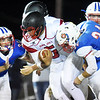 Midland Trail's Adam Gill (34) and Hunter Darby (24) tackle Oak Hill quarterback Christian Lively (5) on a carry during their high school football game Friday in Hico. (Chris Jackson/The Register-Herald)
