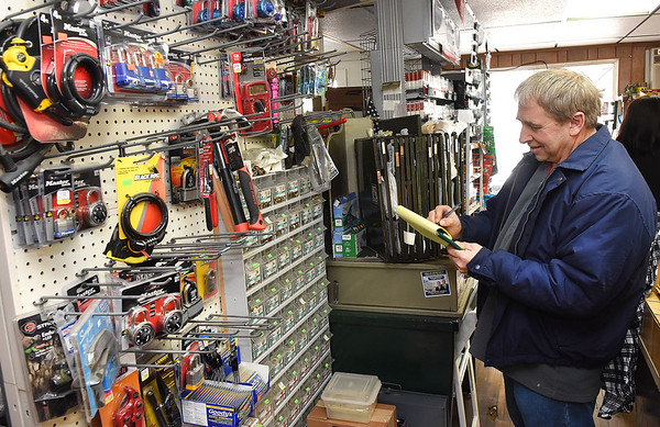Gary Jarrell, owner, make a list of items he needs at Charles B. Jarrell General Store on Coal River Road in Dry Creek<br /> (Rick Barbero/The Register-Herald