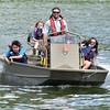 (Brad Davis/The Register-Herald) Young passengers (from left) Sylar Hartwell, 8, his sister Zylah (up in the seat), 6, and Madison Adkins, 11, hang on and enjoy the ride as National Park Service River Ranger Bill Parker takes them for a speedy run on Bluestone Lake during Safety on the Blue Sunday afternoon. Abigail Reed, 8, was also on the boat but hidden behind driver Parker.
