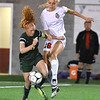 (Brad Davis/The Register-Herald) Cabell Midland's Aubrey Howard-Brown battles for possession with Greenbrier East's Kate Perkins during Class AAA Girls State Soccer Tournament action Friday night the YMCA Paul Cline Memorial Sports Complex.