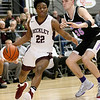 (Brad Davis/The Register-Herald) Woodrow Wilson's Isaiah Francis speeds around Riverside's Jordan Butcher during the Flying Eagles' win over the Warriors Wednesday night at the Beckley-Raleigh County Convention Center.