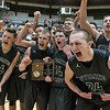 (Brad Davis/The Register-Herald) A fired-up Warrior team reacts to a swarm of cameras after Wyoming East defeated cross-county rival Westside for the Class AA Region 3, Section 1 championship Saturday night at the Beckley-Raleigh County Convention Center.
