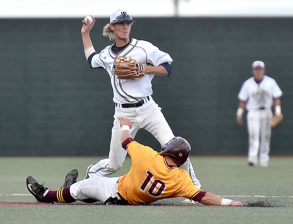 (Brad Davis/The Register-Herald) Shepherd shortstop Trenton Burgreen forces out Charleston's Colby Johnson, who slides too far out of the basepath attempting to break up the double play, leading to an interference call and UC batter Tyler Neil being called out at first after initially beating out the throw during the Mountain East Conference Championship game Sunday evening at Linda K. Epling Stadium.