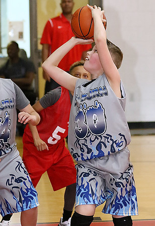 (Brad Davis/The Register-Herald) WV Burn's (Morgantown) Ty Egnat pulls up for a jump shot against Huntington Red during 4th grade Biddy Buddy action Saturday at the YMCA.