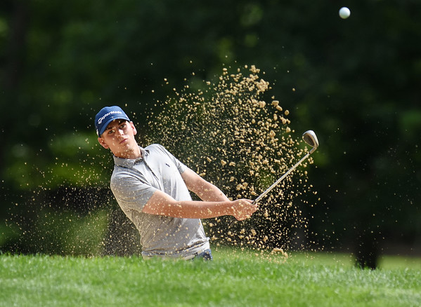 Landon Perry hits out of a sand trap on the 11 hole onto the green of The Cobb Course during the championship round of the annual BNI Tournament Monday at The Resort at Glade Springs. (Chris Jackson/The Register-Herald)