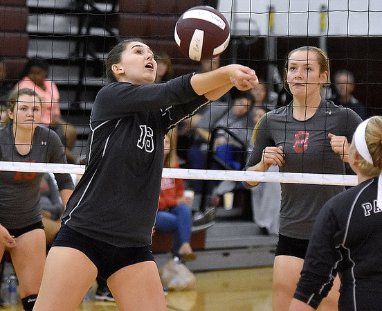 (Brad Davis/The Register-Herald) Independence's Mykal Daniel scrambles to return a ball against Cabell Midland during the Shirley Brown Invitational Volleyball Tournament Saturday afternoon at Woodrow Wilson High School.
