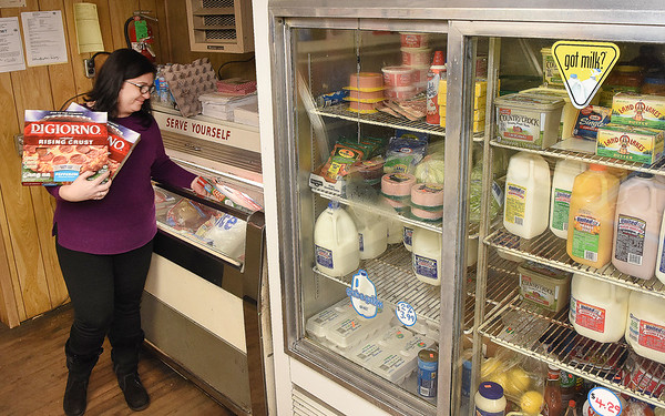 Valerie Blaylock stocks up a freezer at Charles B. Jarrell General Store on Coal River Road in Dry Creek<br /> (Rick Barbero/The Register-Herald