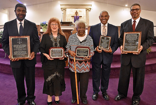 (Brad Davis/The Register-Herald) This year's group of honorees pose with their plaques following Heart of God Ministries' Black History Month celebration Sunday evening. From left are Judge Booker T. Stephens, Sister Shirley Treadway, former Dubois High School teacher Eunice Fleming, Miller Hall, and keynote speaker Dr. Geoffrey Cousins.