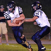 (Brad Davis/The Register-Herald) Greenbrier West's Chase Patterson gets the handoff from teammate Chad Ramsey Friday night in Hinton.
