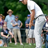 (Brad Davis/The Register-Herald) Greenbrier Classic winner Xander Schauffele watches his putt for par on #9 before it falls in during final round Greenbrier Classic action Sunday afternoon in White Sulphur Springs.
