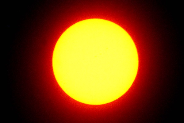 Solar eclipse at 1:05<br /> (Rick Barbero/The Register-Herald)