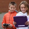 Ethan Sullivan, left, looks over the activity of a drone he's flying on an iPad held by Lacey Goodson. Both students in Taylor Ray's third grade class at Sophia Soak Creek Elementary School.<br /> (Rick Barbero/The Register-Herald)