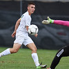 Robert C Byrd's Emilio Buffey scores a goal past Weir's goalkeeper Brett Hinchee during their semi-final AA-A boys soccer match during the West Virginia State Soccer Tournament in Beckley on Friday. (Chris Jackson/The Register-Herald)