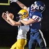 (Brad Davis/The Register-Herald) Clay County receiver Isaac Workman makes a nice catch on a deep pass despite good coverage from Independence's Connor Gobson Friday night in Coal City.