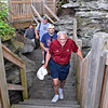 (Brad Davis/The Register-Herald) Cincinnati, Ohio resident Rich Seeger leads the way as Cleveland resident Geoff Baron and fellow Cincinnati residents John Patton and Steve Seeger trek up the new walkways on the way to the Turkey Spur overlooks that are now open follwing a ceremony Friday evening at Grandview Park.
