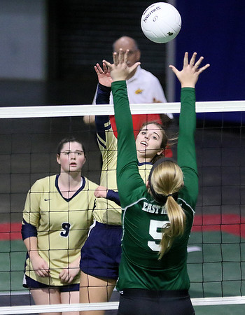 (Brad Davis/The Register-Herald) Greenbrier West's Rachel Adkins spikes the ball as East Hardy's Brooke Miller tries to block it during State Volleyball Tournament action Friday morning at the Charleston Civic Center.