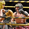 (Brad Davis/The Register-Herald) Oak Hill's Robert Laughery, right, takes on Cameron Harvey in a lightweight matchup during the Original Toughman Contest Friday night at the Beckley-Raleigh County Convention Center. Laughery would win the fight.