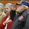 (Brad Davis/The Register-Herald) Air Force veteran Alan Wells salutes the flag as attendees sing the Star Spangled Banner during Fayetteville's annual Veteran's Appreciation Day ceremony at the Fayette County Soldier's and Sailor's Memorial Building Sunday afternoon.