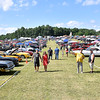 (Brad Davis/The Register-Herald) Enthusiasts browse the hundreds of classic and custom rides during the Friends of Coal Auto Fair Saturday afternoon at the Raleigh County Memorial Airport.
