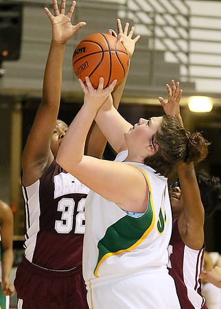 (Brad Davis/The Register-Herald) Greenbrier East's Piper Nunley drives and scores as Woodrow Wilson's Victoria Staunton reaches for it during Big Atlantic Classic action Thursday night at the Beckley-Raleigh County Convention Center.