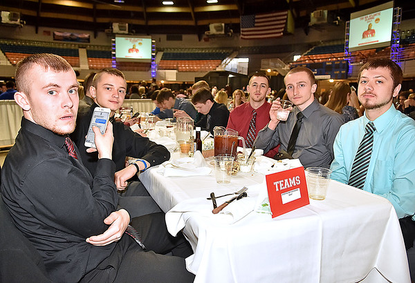 (Brad Davis/The Register-Herald) A slightly suprised Wyoming East boys team during the Big Atlantic Classic Tip-Off Banquet Sunday afternoon at the Beckley-Raleigh County Convention Center.