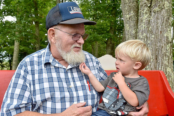 """(Brad Davis/The Register-Herald) In a re-creation of a photo taken at the 1946 reunion that ran in Life Magazine, two-year-old Gunner Lilly tugs on the beard 74-year-old Arnold Lilly, who was just four when he was photographed tugging the beard of the late """"Uncle"""" Pleasant Lilly, who was 102 at that time."""