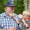 "(Brad Davis/The Register-Herald) In a re-creation of a photo taken at the 1946 reunion that ran in Life Magazine, two-year-old Gunner Lilly tugs on the beard 74-year-old Arnold Lilly, who was just four when he was photographed tugging the beard of the late ""Uncle"" Pleasant Lilly, who was 102 at that time."