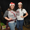 (Brad Davis/The Register-Herald) Volunteers Taylor Stewart, left, and Kelsey Knoops strike a pose during the annual Mac's Toy Fund event Saturday morning at the Beckley-Raleigh County Convention Center.