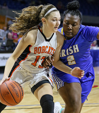 (Brad Davis/The Register-Herald) Summers County's Hannah Taylor tries to score against solid defense from St. Joseph Central's Tyesha Taylor in the paint Friday afternoon at the Charleston Civic Center.
