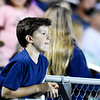 A youth looks on in the Meadow Bridge bleachers drink their football game against Webster County Friday in Meadow Bridge. (Chris Jackson/The Register-Herald)