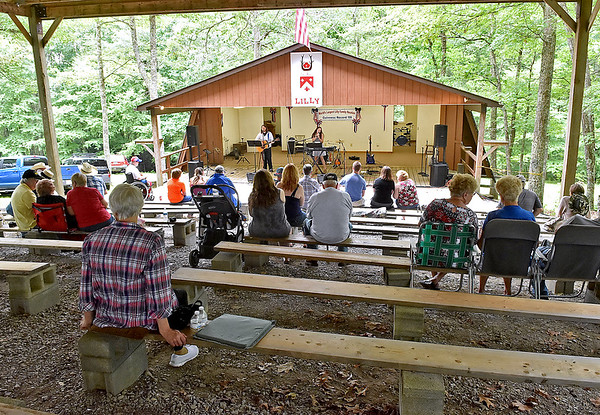 (Brad Davis/The Register-Herald) Attendees take in some of the entertainment during the annual Lilly Family Reunion Saturday afternoon near Ghent.