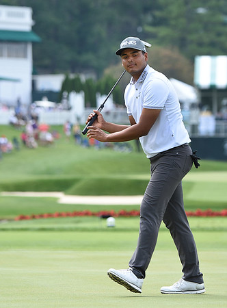 Sabastian Munoz watches his birdie putt he just missed on the 17th hole during the second round of The Greenbrier Classic.<br /> (Rick Barbero/The Register-Herald)