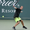 (Brad Davis/The Register-Herald) Tennis legend Pete Sampras plays against James Blake during the Greenbrier Champions Tennis Classic Saturday afternoon in White Sulphur Springs.