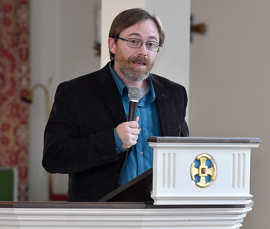 (Brad Davis/The Register-Herald) Dr. Ryan Snuffer, founder of the Appalachan Community Mission, speaks during the vigil for peace and unity at St. Stephens Episcopal Wednesday night.